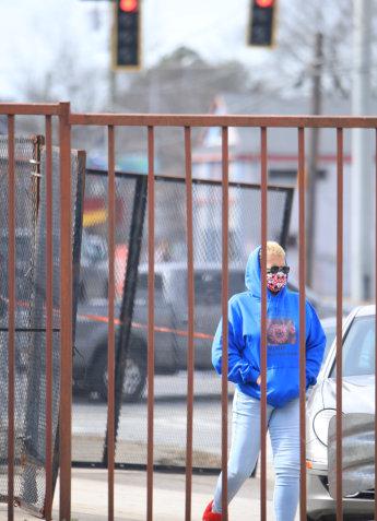 woman in blue hood