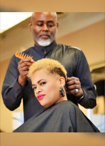 man combing woman's hair